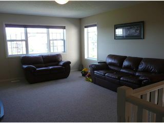 Photo 13: 70 ROCKYSPRING Circle NW in CALGARY: Rocky Ridge Ranch Residential Detached Single Family for sale (Calgary)  : MLS®# C3493243