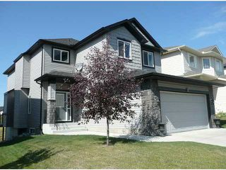 Photo 1: 70 ROCKYSPRING Circle NW in CALGARY: Rocky Ridge Ranch Residential Detached Single Family for sale (Calgary)  : MLS®# C3493243