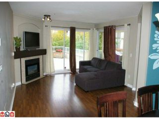 "Photo 3: 108 20125 55A Avenue in Langley: Langley City Condo for sale in ""BLACKBERRY LANE 2"" : MLS®# F1200974"