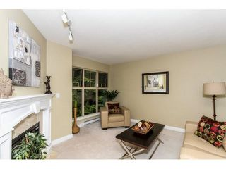"Photo 2: 17 65 FOXWOOD Drive in Port Moody: Heritage Mountain Townhouse for sale in ""FOREST HILL"" : MLS®# V1125839"