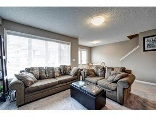 Photo 6: 113 WINDSTONE Mews SW: Airdrie House for sale : MLS®# C4016126