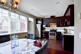 """Photo 8: 51 15399 GUILDFORD Drive in Surrey: Guildford Townhouse for sale in """"Guildford Green"""" (North Surrey)  : MLS®# R2053627"""