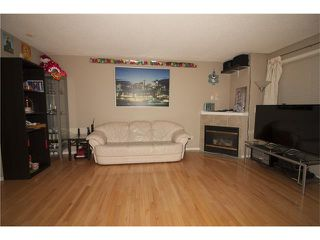 Photo 5: 1001 111 TARAWOOD Lane NE in Calgary: Taradale House for sale : MLS®# C4059766