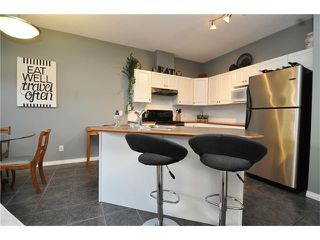 Photo 2: 102 2 WESTBURY Place SW in Calgary: West Springs House for sale : MLS®# C4087728