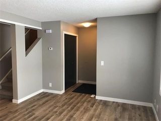 Photo 3: 1015 RIVERBEND Drive SE in Calgary: Riverbend House for sale : MLS®# C4091887