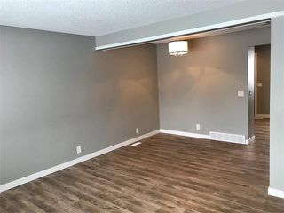 Photo 2: 1015 RIVERBEND Drive SE in Calgary: Riverbend House for sale : MLS®# C4091887