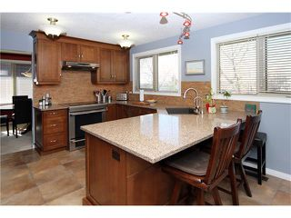 Photo 6: 51 RANCH ESTATES Road NW in Calgary: Ranchlands House for sale : MLS®# C4107485
