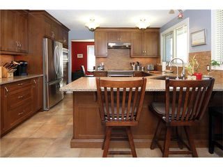 Photo 7: 51 RANCH ESTATES Road NW in Calgary: Ranchlands House for sale : MLS®# C4107485