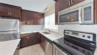 Photo 4: 495 AUBURN BAY Avenue SE in Calgary: Auburn Bay House for sale : MLS®# C4148969