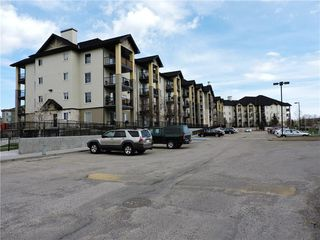 Photo 2: 8302 304 MACKENZIE Way SW: Airdrie Apartment for sale : MLS®# C4222682