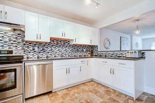"Photo 1: 1245 BLUFF Drive in Coquitlam: River Springs House for sale in ""River Springs"" : MLS®# R2357024"