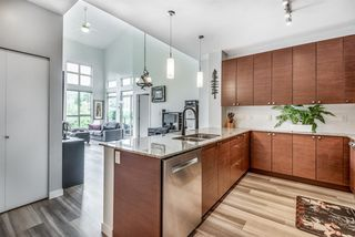 """Photo 3: 412 101 MORRISSEY Road in Port Moody: Port Moody Centre Condo for sale in """"Libra at Suter Brook"""" : MLS®# R2472605"""