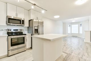 """Photo 2: 401 5650 201A Street in Langley: Langley City Condo for sale in """"Paddington Station"""" : MLS®# R2517171"""