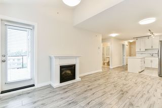 """Photo 11: 401 5650 201A Street in Langley: Langley City Condo for sale in """"Paddington Station"""" : MLS®# R2517171"""
