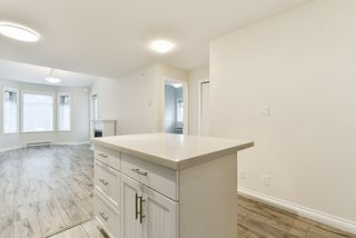 """Photo 3: 401 5650 201A Street in Langley: Langley City Condo for sale in """"Paddington Station"""" : MLS®# R2517171"""