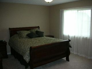 Photo 7: 1212 - 84 Street  SW: House for sale (Summerside)