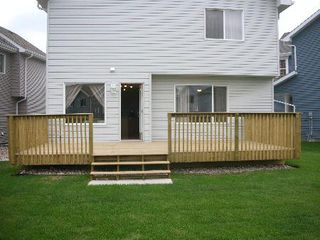 Photo 10: 1212 - 84 Street  SW: House for sale (Summerside)