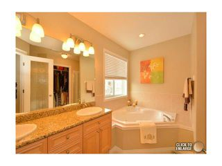 Photo 11: 89 STRATHRIDGE Close SW in Calgary: Strathcona Park Residential Detached Single Family for sale : MLS®# C3647203