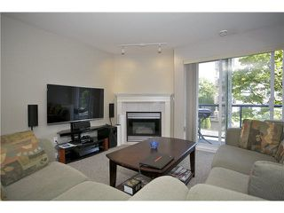 "Photo 3: 207 20277 53 Avenue in Langley: Langley City Condo for sale in ""Metro II"" : MLS®# F1446990"
