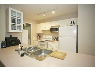"Photo 9: 207 20277 53 Avenue in Langley: Langley City Condo for sale in ""Metro II"" : MLS®# F1446990"