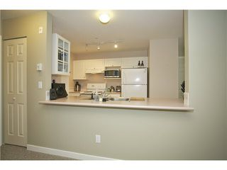 "Photo 8: 207 20277 53 Avenue in Langley: Langley City Condo for sale in ""Metro II"" : MLS®# F1446990"