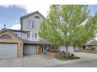 Photo 1: 22 COACHWAY Green SW in Calgary: 4 Level Split for sale : MLS®# C3572923
