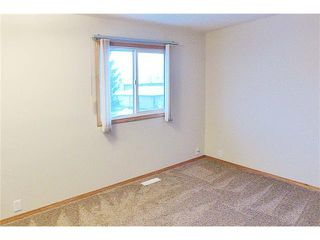 Photo 13: 1124 CANTERBURY Drive SW in Calgary: Canyon Meadows House for sale : MLS®# C4092925