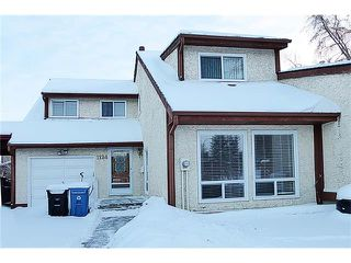 Photo 1: 1124 CANTERBURY Drive SW in Calgary: Canyon Meadows House for sale : MLS®# C4092925