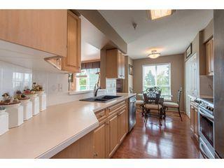 "Photo 9: 313 13860 70 Avenue in Surrey: East Newton Condo for sale in ""CHELSEA GARDENS"" : MLS®# R2175558"