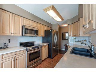 "Photo 8: 313 13860 70 Avenue in Surrey: East Newton Condo for sale in ""CHELSEA GARDENS"" : MLS®# R2175558"
