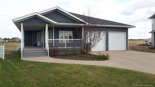 Main Photo: 6911 Meadowview Close in Stettler: Meadowlands Residential for sale : MLS®# CA0168426
