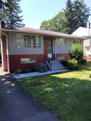 Photo 1: 9111 148TH Street in Surrey: Bear Creek Green Timbers House for sale : MLS®# R2388904