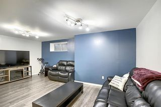 Photo 36: 1049 Hillcrest Lane SW: Airdrie Semi Detached for sale : MLS®# A1031082