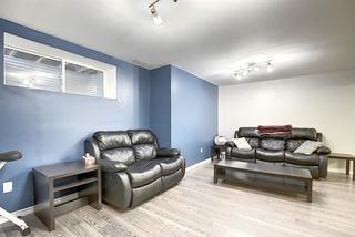 Photo 37: 1049 Hillcrest Lane SW: Airdrie Semi Detached for sale : MLS®# A1031082