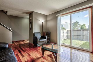 Photo 7: 63 219 90 Avenue SE in Calgary: Acadia Row/Townhouse for sale : MLS®# A1032185