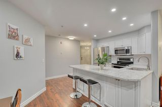 Photo 3: 102 735 56 Avenue SW in Calgary: Windsor Park Apartment for sale : MLS®# A1033064