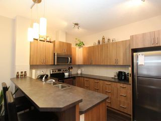 Photo 6: 517 10 AUBURN BAY Avenue SE in Calgary: Auburn Bay Townhouse for sale : MLS®# C3603479