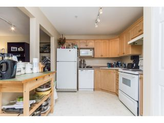 "Photo 4: 201A 301 MAUDE Road in Port Moody: North Shore Pt Moody Condo for sale in ""HERITAGE GRAND"" : MLS®# R2077072"