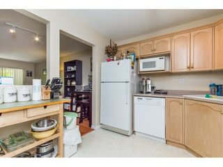 "Photo 3: 201A 301 MAUDE Road in Port Moody: North Shore Pt Moody Condo for sale in ""HERITAGE GRAND"" : MLS®# R2077072"
