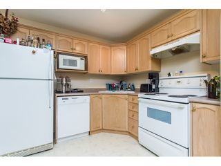 "Photo 6: 201A 301 MAUDE Road in Port Moody: North Shore Pt Moody Condo for sale in ""HERITAGE GRAND"" : MLS®# R2077072"