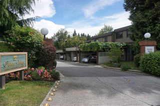 "Photo 1: 3911 PARKWAY Drive in Vancouver: Quilchena Townhouse for sale in ""ARBUTUS VILLAGE"" (Vancouver West)  : MLS®# R2080409"