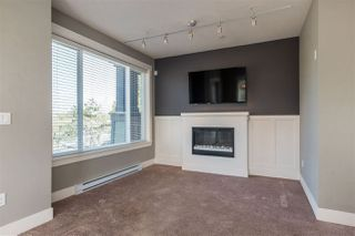 """Photo 2: 203 5665 177B Street in Surrey: Cloverdale BC Condo for sale in """"LINGO"""" (Cloverdale)  : MLS®# R2259852"""