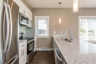"""Photo 6: 203 5665 177B Street in Surrey: Cloverdale BC Condo for sale in """"LINGO"""" (Cloverdale)  : MLS®# R2259852"""