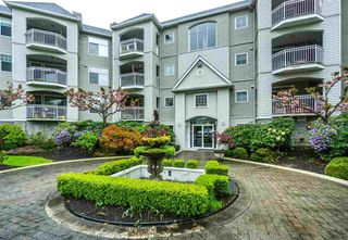 "Photo 1: 113 5677 208 Street in Langley: Langley City Condo  in ""IVY LEA"" : MLS®# R2261004"