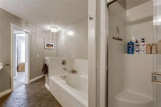 Photo 18: 93 SOMME Boulevard SW in Calgary: Garrison Woods Row/Townhouse for sale : MLS®# C4241800
