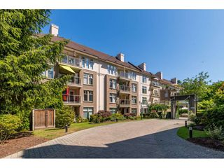 "Photo 1: 414 15350 19A Avenue in Surrey: King George Corridor Condo for sale in ""Stratford Gardens"" (South Surrey White Rock)  : MLS®# R2392580"