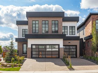 Photo 1: 7817 8A Avenue SW in Calgary: West Springs Detached for sale : MLS®# A1053285