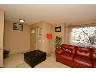 Photo 7: 202 ARBOUR MEADOWS Close NW in Calgary: Arbour Lake House for sale : MLS®# C4048885