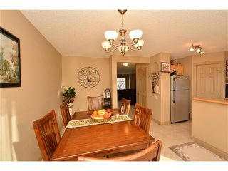 Photo 12: 202 ARBOUR MEADOWS Close NW in Calgary: Arbour Lake House for sale : MLS®# C4048885