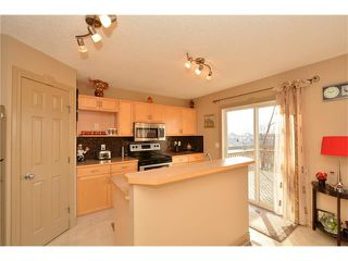 Photo 14: 202 ARBOUR MEADOWS Close NW in Calgary: Arbour Lake House for sale : MLS®# C4048885
